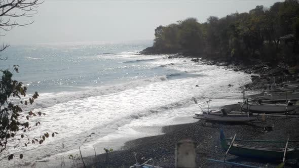 Thumbnail for Drive by view of a rocky coastline beach.