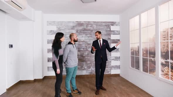 Thumbnail for Successful Real Estate Agent Talking with Young Couple