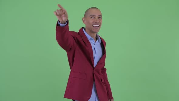 Thumbnail for Happy Bald Multi Ethnic Businessman Pointing Finger
