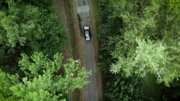 Gray car on the road. Sky view of summer road with cars. Aerial view country road in summer