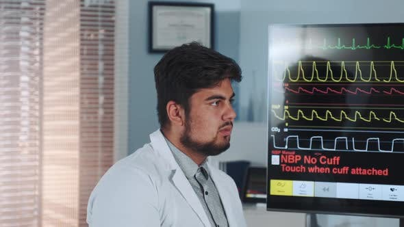 Thumbnail for Close-up of Mixed Race Doctor Learning EKG Data Showed on Big Display