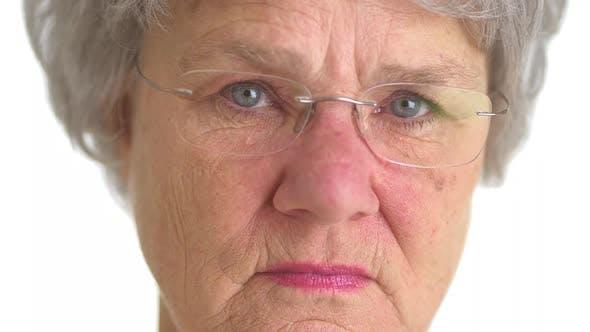 Thumbnail for Elderly woman staring at camera