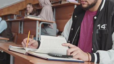 Bearded Male Student Cheating at Exam