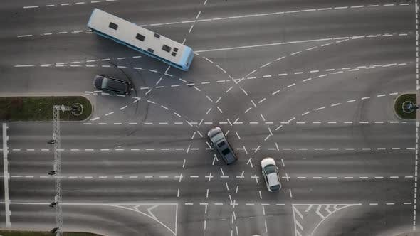 Cover Image for Vehicles Driving In City Intersection Aerial View