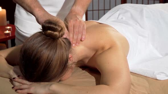 Thumbnail for Professional Masseur Doing Relaxing Back Massage for Female Client