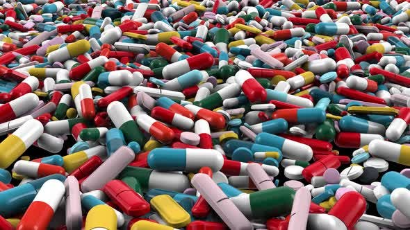 Thumbnail for Pile of Different Colors Pharmaceutical Capsules and Pills Closeup, Dolly Move