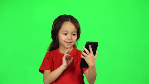 Little Dark-haired Girl with Phone