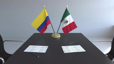 Flags of Colombia and Mexico and Papers on the Table