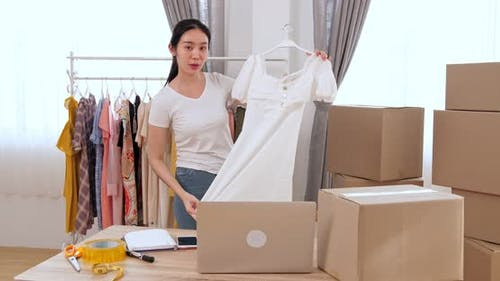 Female Fashion Vlogger Presenting Dress