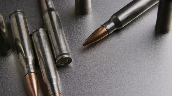 Cinematic rotating shot of bullets on a metallic surface - BULLETS 006