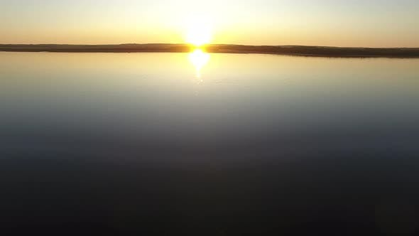 Cover Image for Flying Over Water Towards Sun