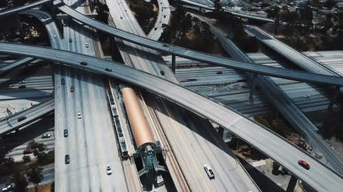 Drone Aerial View of a Large Highway Road Intersection in Los Angeles, USA with Complex System of