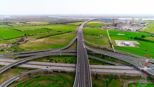 Thumbnail for Aerial drone view of highway multi-level junction road with moving cars (Stock Footage)