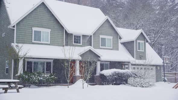 Home exterior in snow storm