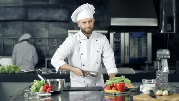 Cover Image for Professional Chef Preparing To Cook at Kitchen