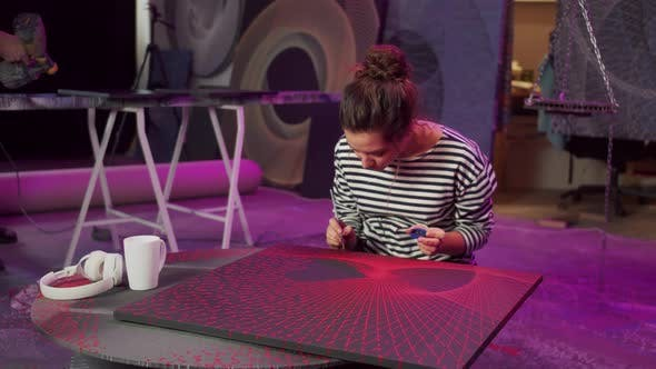 An Artist is Drawing a Picture