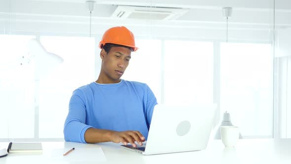 Cover Image for Afro-American Engineer Working On Laptop in Office
