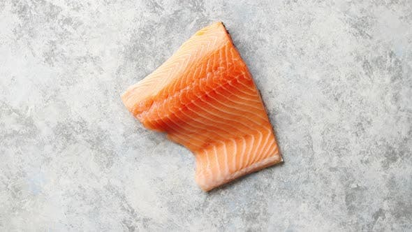 Thumbnail for Raw Fresh Salmon Meat Placed on Gray Stone Background