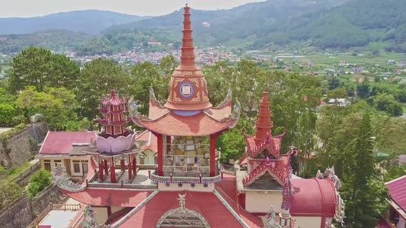 Thumbnail for Flycam Removes From Temple Buildings High Above Landscape