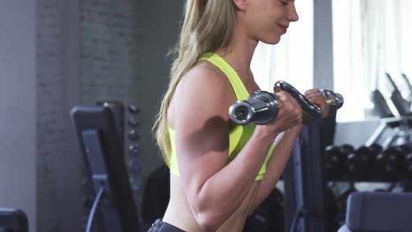 Thumbnail for Gorgeous Cheerful Sportswoman Doing Biceps Exercise at the Gym