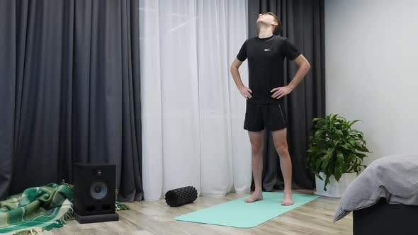 Thumbnail for Athletic fit boy doing fitness and aerobic exercises on yoga mat.