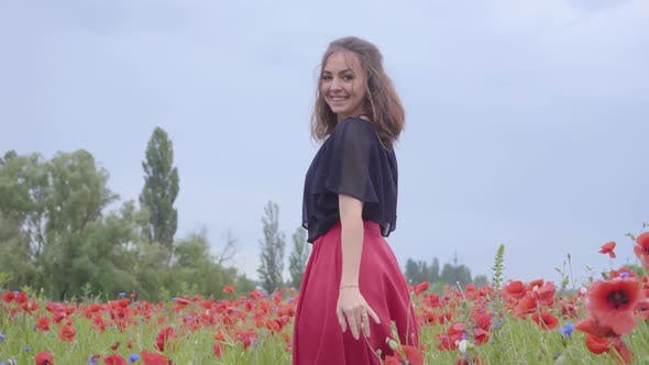 Thumbnail for Portrait of Pretty Girl Running and Dancing in a Poppy Field Smiling Happily