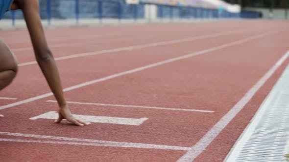 Cover Image for Multiracial girls getting to crouch start, running after command, way to success