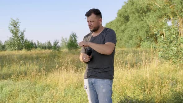 Middleaged Male Making Coffee in Nature Summer Sunny Day