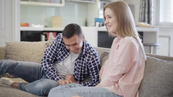 Thumbnail for Positive Loving Couple Having Fun on Couch in Living Room