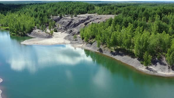Thumbnail for Flying over the lake in the abandoned clay quarry.