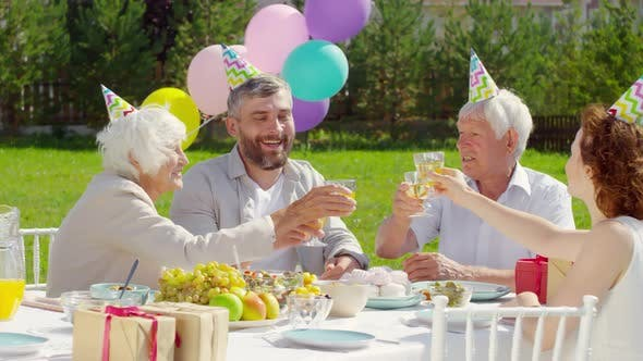 Cover Image for Family Couple and Grandparents Toasting with Wine on Outdoor Dinner Party