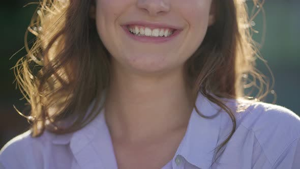 Thumbnail for Close-up Shot of Pretty Young Caucasian Female Mouth Laughing