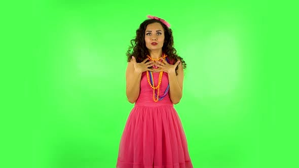 Thumbnail for Lovely Girl Tells Something Then Making a Hush Gesture, Secret. Green Screen at Studio