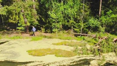 Elderly Woman Enjoy Nordic Walking In Nature