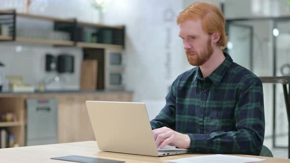 Thumbnail for Beard Redhead Man with Laptop Pointing at the Camera