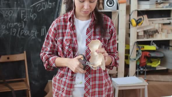 Thumbnail for Asian Craftswoman Working To Music