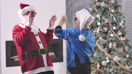 Thumbnail for Positive Senior Caucasian Man and Woman Playing Clapping Game and Starting Fun Dancing
