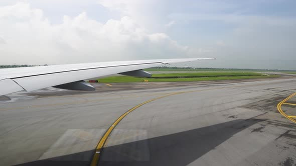 Thumbnail for the Plane Taxiing To the Runway. View of the Wing From the Airplane Window