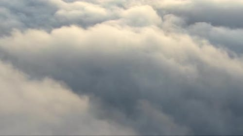 Flying Above the Clouds Puffs of Steam Underfoot Feeling of Elevation and Lightness