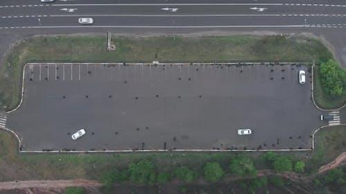 Vehicle starting driving examination, demonstrating turning maneuvering. Asphalt autodrome