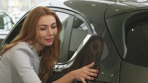 Thumbnail for Gorgeous Woman Examining a New Car at the Dealership