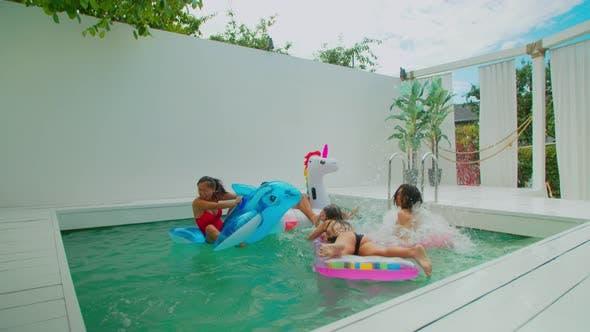 Carefree Arab Man Jumping Into Swimming Pool