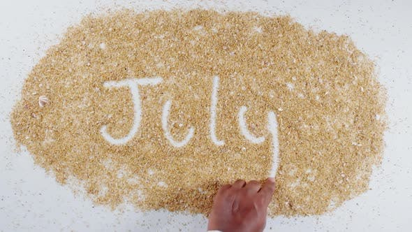 Hand Writes On Sand   July