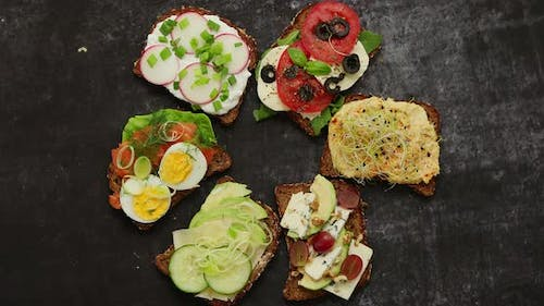 Healthy Vegan Sandwiches Made From Homemade Buckwheat Bread with Various Toppings