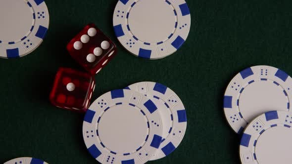 Rotating shot of poker cards and poker chips on a green felt surface - POKER 016
