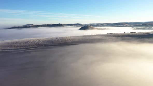 Flying Over Hills in mystic Foggy Winter Morning
