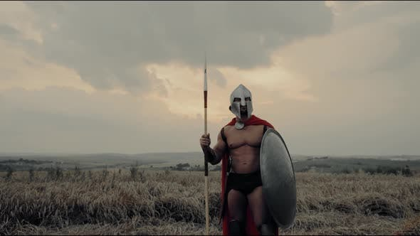 Thumbnail for Shirtless Spartan Raising Hands in Dry Field