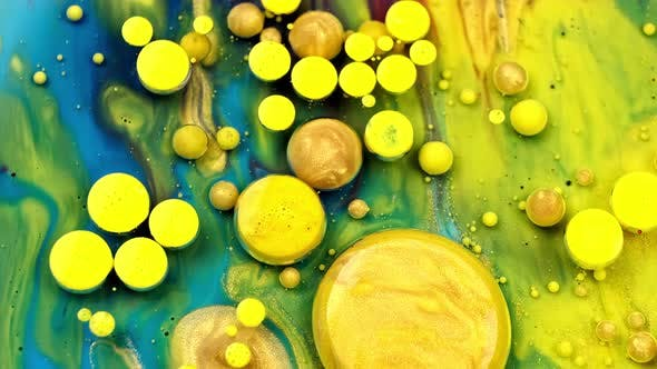 Blue and Yellow Inks React To Form a Beautiful Structure of Paint Bubbles. Colorful Liquid Ink