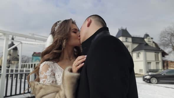 Thumbnail for Newlyweds. Caucasian Groom and Bride Making a Kiss. Wedding Couple. Happy Family