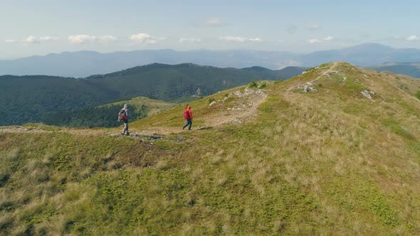 Thumbnail for Hikers On Hill Slope, Walking on Rocky Path
